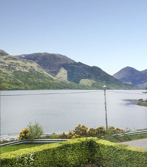 View from the upstairs bedroom to The Five Sisters of Kintail